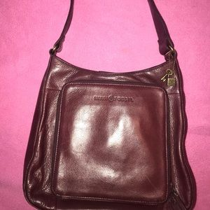 Fossil handbag in color burgundy
